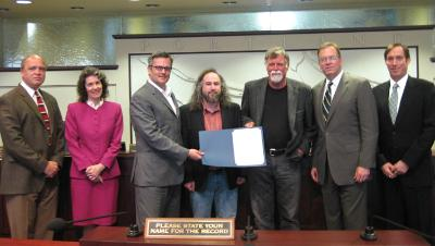 Bob Sallinger, Portland Audubon Society, and Mike Houck, Urban Greenspaces Institute, pose with City Council.