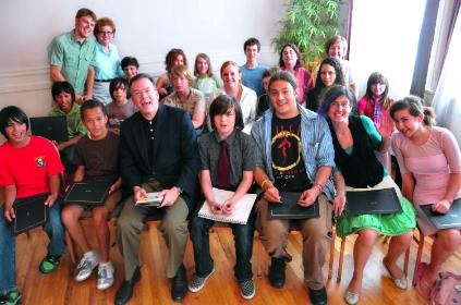 Commissioner Nick Fish joins the graduates of REACH CDC's Youth$ave program this past week.