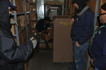 Rose City Movers loading the first box