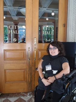 Picture of disability coordinator in front of City Hall
